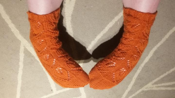 Sauna socks made with orange Novita Nalle yarn